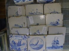 A group of fourteen 18th and early 19th century Dutch Delft tiles, painted in blue and white with