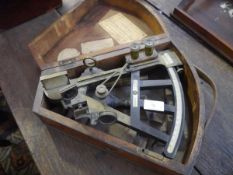 """An early 19th century brass and ebonised sextant, with ivory/bone scale and maker's label """"Canni &"""