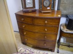 An early Victorian bowfronted mahogany chest of drawers, the top with reeded edge over two short and