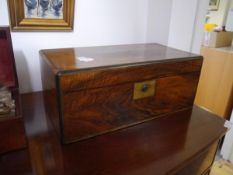 An Edwardian walnut writing slope, with engraved gilt-brass plaque, of rectangular form and