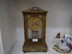 A French late 19th century champleve enamel and onyx mantel clock, the gilt dial with Roman numerals