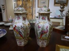 A pair of large porcelain hexagonal baluster vases and covers, possibly Samson of Paris, painted