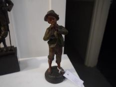 """A French spelter figure of a boy playing a horn, signed Kessler and marked """"France"""". 23cm"""