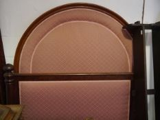 A 19th century mahogany framed double bed, with arched upholstered headboard, the footboard with
