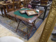 An Edwardian inlaid mahogany folding bezique/games table, the baize inset top inlaid with flower