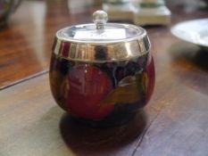 A William Moorcroft preserve jar in the Pomegranate pattern, with electroplated mount and cover,