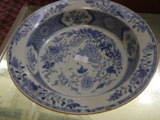 A Chinese blue and white porcelain wash bowl, the rim and well painted with floral sprays and a