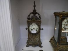 A French 19th century bronze mantel clock, the case elaborately cast with foliate scrolls and