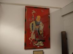 A Chinese 20th century silk panel depicting Shou Lao, standing holding a peach, worked in coloured