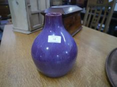 An Ashby Guild pottery vase, c. 1910, of shouldered form with streaked purple glaze, impressed mark.