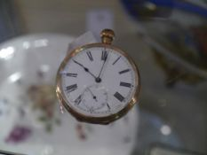 A 14ct yellow gold keyless wind open face pocket watch, the white enamel dial with Roman numerals