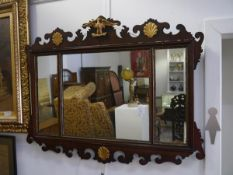A parcel-gilt fretwork mirror in the Georgian taste, the tripartite glass within gilt slips and a