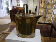 """A brass """"housemaid's"""" watering can, with hinged cover and loop handle. Height 40cm"""