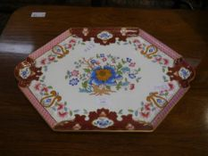 A 19th century porcelain cabaret tray, of shaped hexagonal form, painted to the centre with a floral