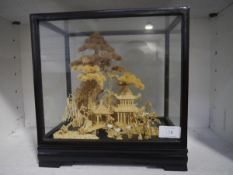 A Chinese cork landscape, early 20th century, modelled as a pagoda pavilion by a pine tree, in an