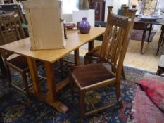 A set of four oak dining chairs in the Arts & Crafts taste, c. 1900, each crest rail carved with Art