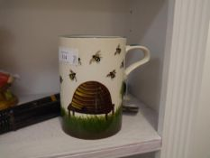 A Griselda Hill Pottery tankard, painted with a hive and bees, painted and impressed marks. 17cm