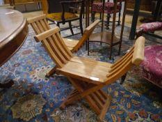 A pair of X-form stools of Savonarola type.