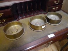 Three shell canister ashtrays, each inset with a medallion