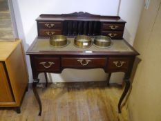 An Edwardian mahogany lady's writing table, the superstructure with an arrangement of pigeon holes