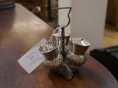 An electro-plated Britannia metal thistle-form three piece condiment set, c. 1900, with thistle loop