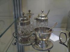 A Victorian silver and cut-glass single egg cruet, James Wakely & Frank Wheeler, London 1887, the