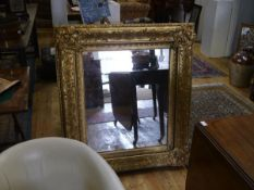A 19th century gilt-composition frame, carved and moulded with scrolls and stylised leaves, now