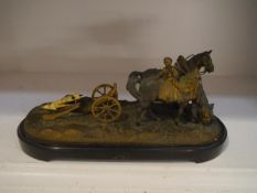French School, 19th Century, a parcel gilt and patinated bronze group of plough horses (a/f), on a