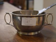 A George V silver twin-handled porringer, Sheffield 1911, engraved with presentation inscription;
