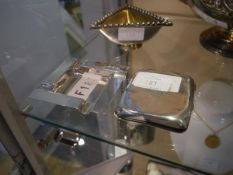 A silver ashtray, Birmingham 1956, square; together with a George V silver cigarette case, George