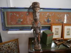 A carved and painted wooden tribal figure, probably Sepik River, Papua New Guinea, depicted standing