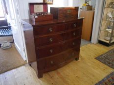 A George III style mahogany bowfronted chest of drawers, early 20th century, with two short over