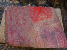 A 19th century woollen Paisley shawl, the centre with red and white reserves, characteristic