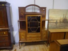 An Edwardian inlaid mahogany vitrine cabinet, with arched glazed crest above an astragal glazed door