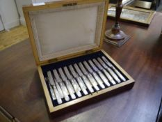 A late Victorian mahogany cased set of twelve fruit knives and forks, each with silver collar marked