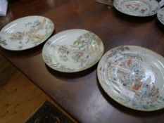 Three Chinese porcelain famille verte shallow dishes, one painted with ladies seated in a garden,