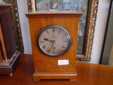 A 1920's oak cased mantel clock, for the Admiralty, the silvered dial with Roman numerals and