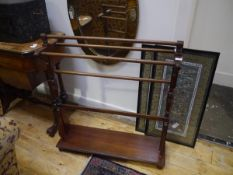 A mahogany towel rail, the three top rails with turned terminals on baluster uprights and a platform