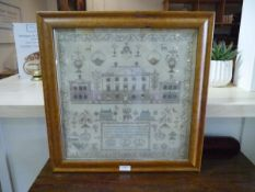 An early 19th century needlework sampler, worked as a Classical country house amidst animals,