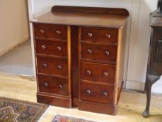 A mid-Victorian walnut collector's chest, the rectangular top with rounded corners above paired