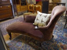 A small 19th century mahogany framed chaise longue, with buttoned back, downscrolled arm and