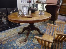 A 19th century mahogany loo table, the oval top with moulded edge raised on a baluster standard