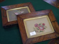 A pair of rosewood framed floral needlework panels. Overall 22cm by 27cm