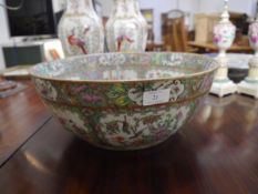 A Chinese Export punch bowl, in the famille rose palette, decorated to the interior and exterior