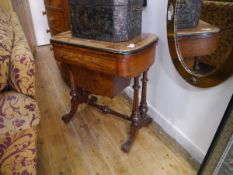 A mid-Victorian inlaid walnut games and work table, the moulded edge top with rounded ends and