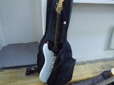 A Fender mint coloured Stratocaster (Mexico) guitar, in carrying case