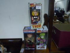 Three boxed Wacky Wobbler figures, two Marvel Comics Green Goblin and The Mighty Thor, the third