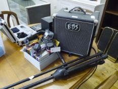 A group of music equipment including Classic Session 30 amp, microphone stands, various cables,