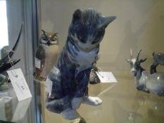A Royal Copenhagen porcelain model of a seated grey cat, no. 340