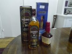 A group of spirits comprising: Bushmills Malt whiskey, 10 years old, boxed; Metaxa Amphora, boxed;